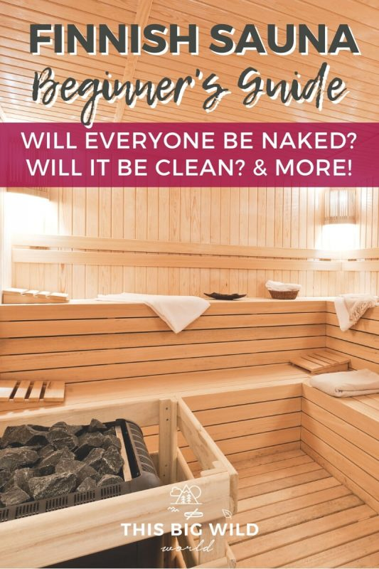 Text: Finnish Sauna Beginner's Guide - will everyone be naked? will it be clean? and more! Image: A clean, wood lined empty sauna with soft white lights and several white towels laying on the benches.