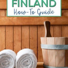 Text: Saunas in Finland How-To Guide Image: A wood-line sauna bench close up with two white towels rolled up sitting next to a wooden bucket.