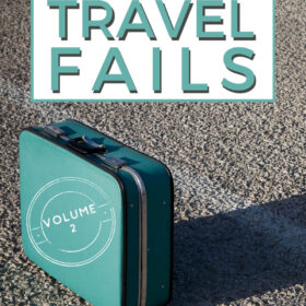 Text: My Biggest Travel Fails - Volume 2 Image: Turquoise vintage suitcase sitting in an empty parking lot, the sun casting a long shadow behind it.