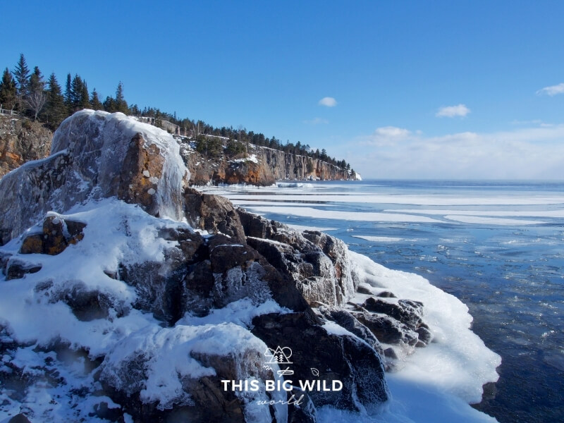 View of Minnesota's rocky north shore covered in ice and snow as viewed from Tettegouche State Park near Two Harbors MN.