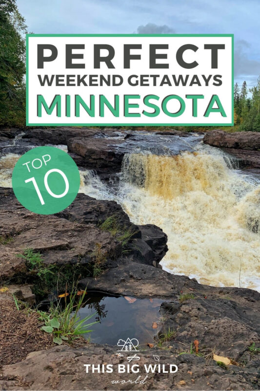 Text: Perfect weekend getaways Minnesota - Top 10 Image: A waterfalls flows over and between dark brown stone lined on either side with green trees and a blue sky overhead.