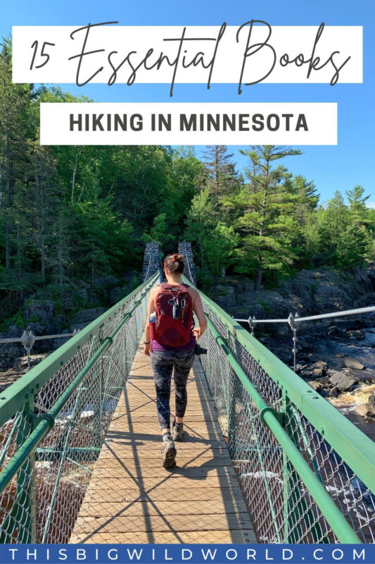 Text: 15 Essential Books Hiking in Minnesota Image: Woman walking away from camera over a suspension bridge wearing hiking gear.