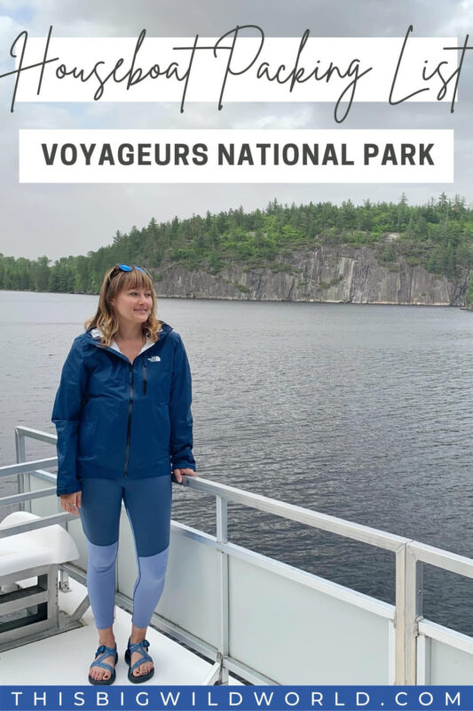 Text: Houseboat Packing List Voyageurs National Park Image: Me Standing on the roof of a houseboat wearing a rain jacket and leggings with sandals.