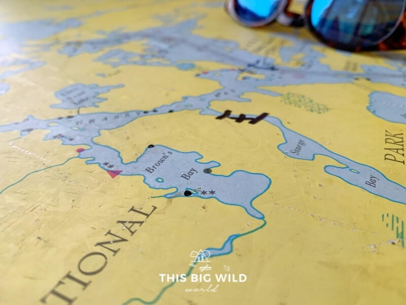 Up close image of a yellow map with blue lakes and waterways representing Voyageurs National Park.