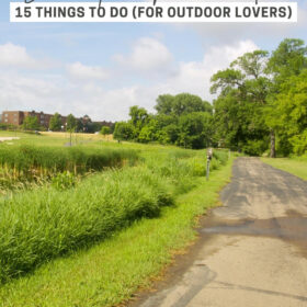 A paved trail runs through Huber Park along the Minnesota River in downtown Shakopee. Text: Shakopee, Minnesota - 15 things to do for outdoor lovers.